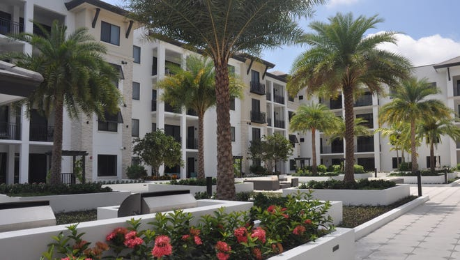 Phase one of Naples Square is complete, phase two is under construction and sales just opened for the third building.