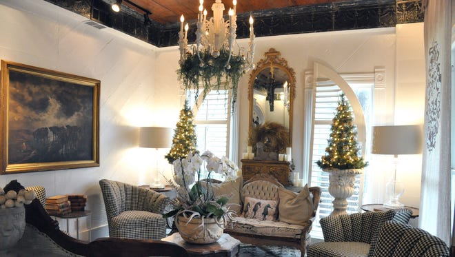The sitting room of the Abilene Landmark boutique hotel features understated holiday decorations. The Victorian Queen Anne house was built in 1889 and will be one of five historic or older residences in the Abilene Woman's Club Holiday Tour of Homes on Dec. 2.
