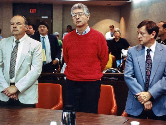 Dr. John Boyle (center) was sentenced to life in prison for the aggravated murder of his wife Noreen in 1990. Attorneys Robert Whitney and Charles Robinson represented him.