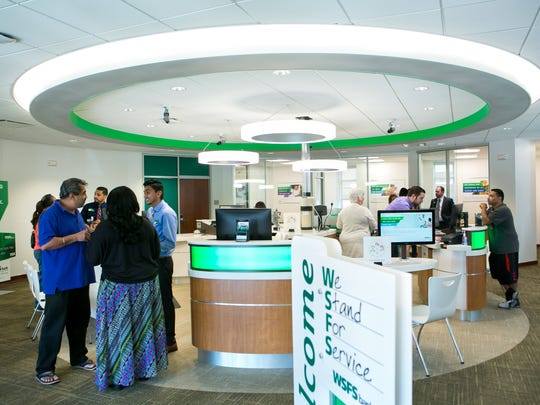 WSFS Bank employees at the North Union Street branch office help customers.