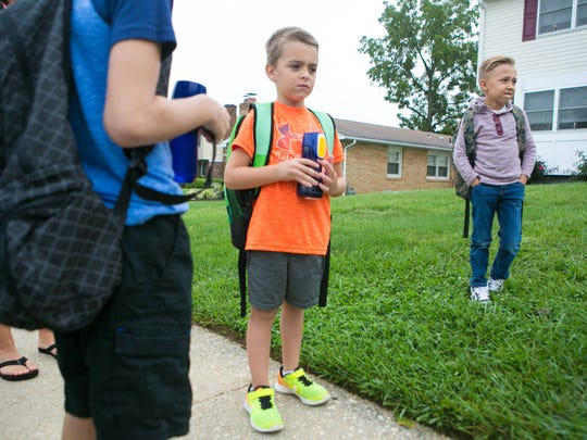 Jacob Pimer (right) walks to school with his friends Madden Spencer (center), 5, and Landon Spencer (left), 8.