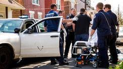 Covington paramedics prepare to take a revived overdose