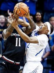Memphis forward Jimario Rivers (right) battles Cincinnati