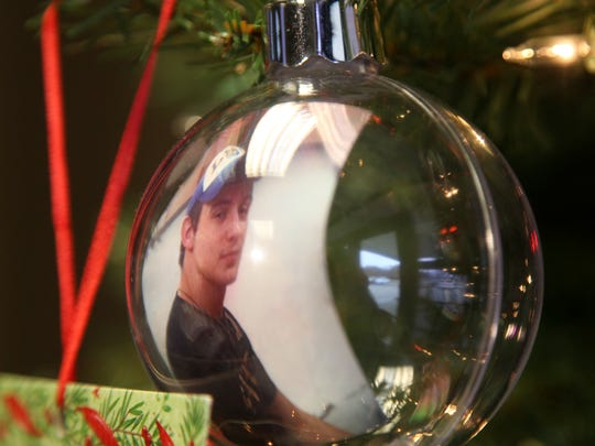 A picture ornament of Michael Woods, who was killed in a 2012 fatality, is included among those on the Mothers Against Drunk Driving holiday tree at the Louisiana State Police Troop F office. People are invited to add photos of family members lost to drunk driving to the tree.