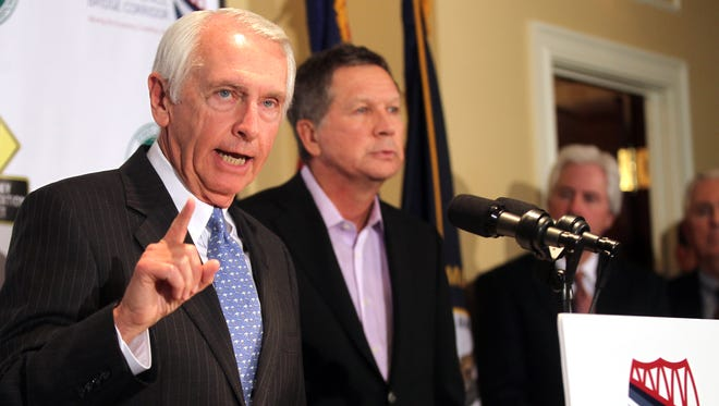 Kentucky Gov. Steve Beshear (left) and Ohio Gov. John Kasich announced plans to get the Brent Spence Bridge Corridor project underway at a press conference at the Metropolitan Club in Covington.