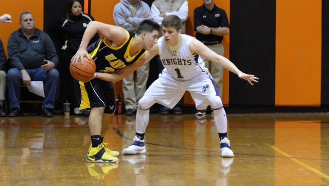 River Dell's David Estevez, left, during last year's Bergen County Tournament, led his team Saturday to a 51-38 win over Bogota in a Jamboree first round game.