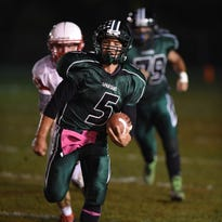 Spackenkill's Kabongo Barry evades Red Hook's Nick Cahill during Friday's game in Poughkeepsie.