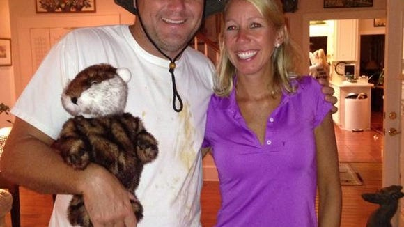 MSU coach Dan Mullen dressed as Carl Spackler from Caddy Shack. His wife Megan, went as Lucy Underall during the coaches' retreat on Monday.