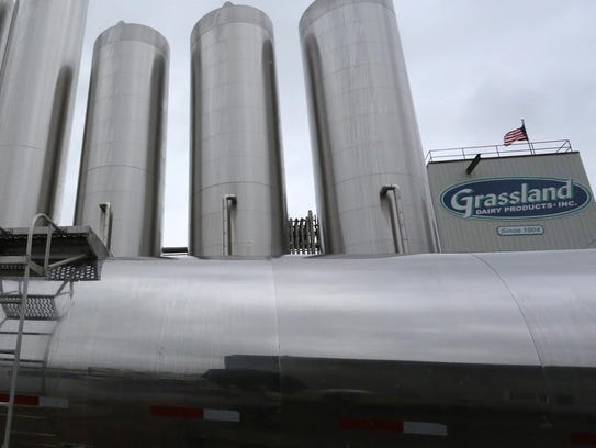 Stainless steel tanks tower over a tank truck at Grassland