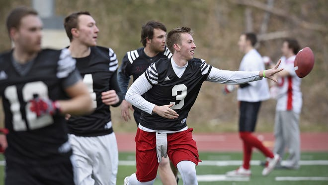 St. John's University quarterback Jackson Erdmann (3) is one of several Johnnies whose fathers are or were head football coaches.
