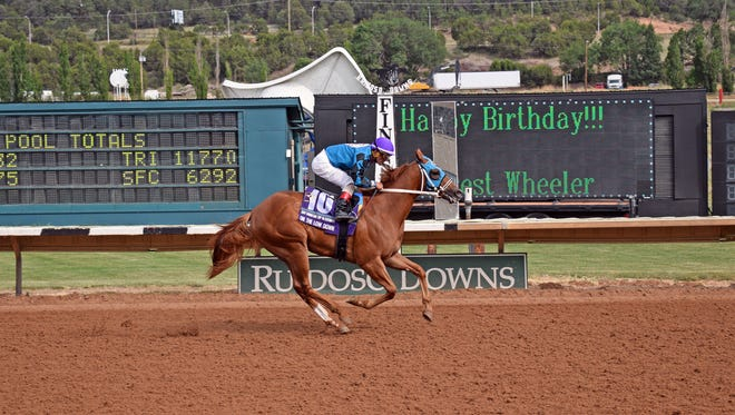 On The Low Down winning the Mountain Top Futurity.