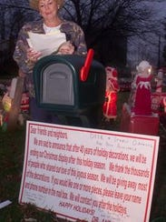 Doris Maro stands at a mailbox that held requests for