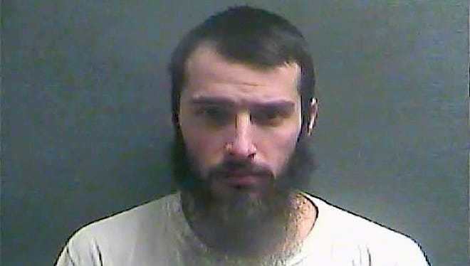 This Jan. 14, 2016, booking photo made available by the Boone County Jail in Burlington, shows Christopher Lee Cornell on the anniversary of his arrest by FBI agents who said he bought weapons for an attack on the U.S. Capitol.