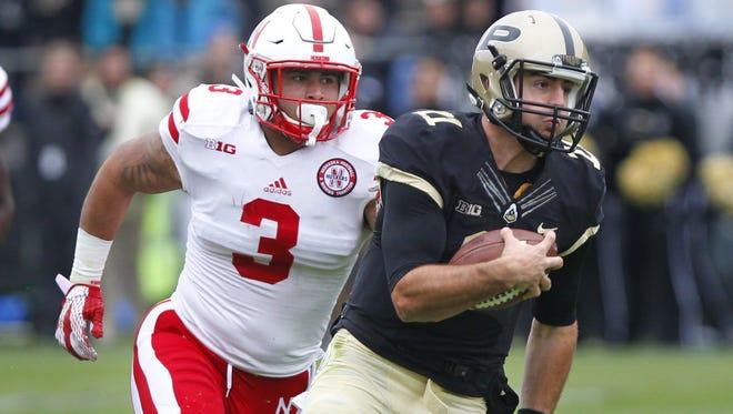 David Blough runs away from Nebraska's Marcus Newby for a touchdown at 5:06 in the fist quarter Saturday, October 31, 2015, at Ross-Ade Stadium. Purdue beat Nebraska 55-45.