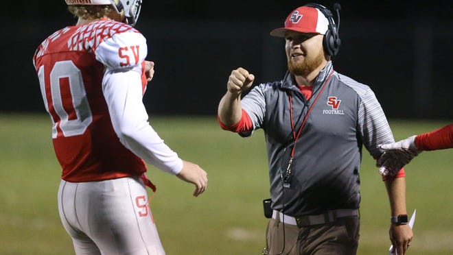 Sandy Valley´s Cameron Blair celebrates a touchdown with head coach Brian Gamble during the first quarter of their game against Strasburg at Sandy Valley on Friday, Oct. 11, 2019.