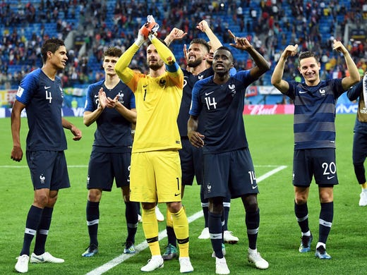 France players celebrate after the win against Belgium.