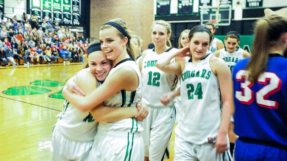 Mountain Heritage girls basketball player celebrate after a win over Madison on Feb. 10 in Burnsville.