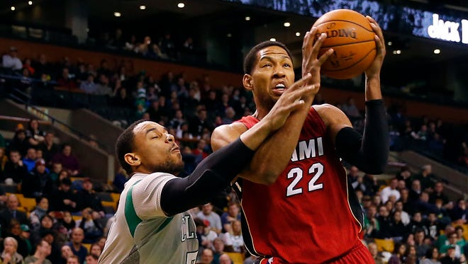 The Boston Celtics' Jared Sullinger tries to stop the Miami Heat's Danny Granger (22) during the first half of a game in Boston, Sunday, Feb. 1, 2015.