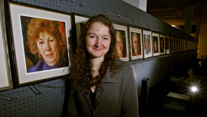 Artist Rose Frantzen painted 180 portraits of her friends and neighbors in a Maquoketa storefront in 2005 and 2006. She's pictured here in 2009.