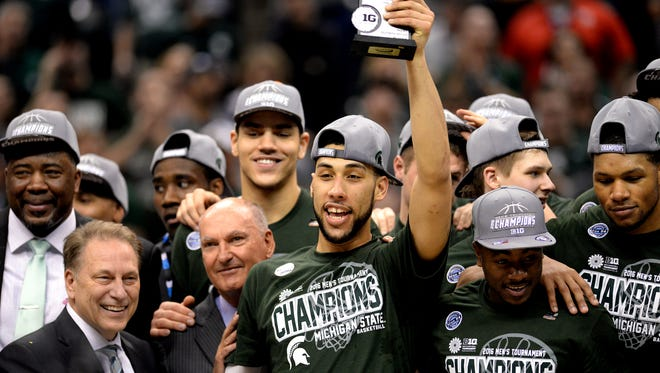 Michigan State senior guard Denzel Valentine (45) raises up the MVP trophy after MSU's 66-62 win over Purdue in the Big Ten Tournament Championship game, Sunday, March, 13, 2016 at Bankers Life Fieldhouse in Indianapolis.