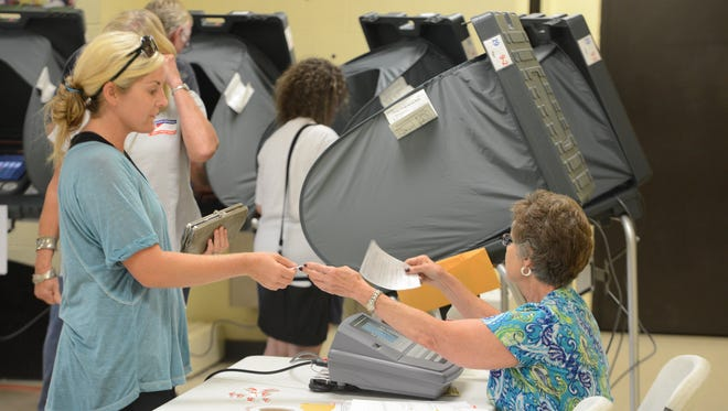 Madison County residents cast their ballots in the 2016 state primary and county general elections Thursday.