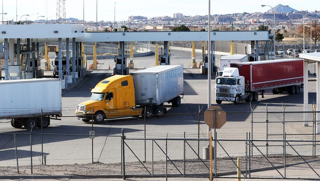 Tractor-trailers file out of the commercial import lot at the Bridge of the Americas after coming over from Mexico on Tuesday.