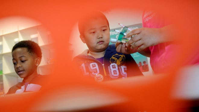 Ethan Zhang, 7 (right) watches a motorized coloring gadget on Monday, Feb. 20, 2017 during the grand opening of Think Tank, a youth makerspace at Impression 5 Science Center in Lansing.