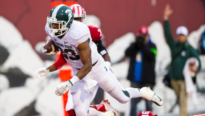 Michigan State RB Jeremy Langford (33) rushes the ball into the end zone to score over IU CB Rashard Fant (16)  during the second half of action.