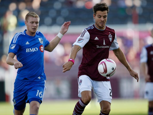 Colorado Rapids midfielder Nick LaBrocca,  right, struggles to control the ball as Montreal Impact defender Calum Mallace covers in the first half of an MLS soccer match in Commerce City, Colo., Saturday, Oct. 10, 2015. (AP Photo/David Zalubowski)