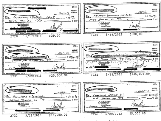 An example of the redacted checks Wolosky received