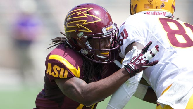 ASU cornerback Ronald Lewis blocks wide receiver Gary Chambers during a gold vs. maroon game at Sun Devil Stadium during Fanfest on April 19,2014.