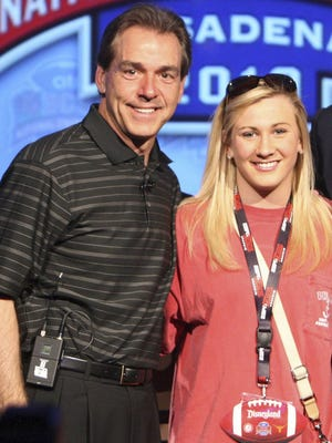 In this Jan. 2, 2010, file photo, Alabama football coach Nick Saban and his daughter Kristen Saban pose during a press conference at the ESPN Zone at Disneyland in Anaheim, Calif.  A judge in Tuscaloosa was wrong to throw out a lawsuit claiming Kristin Saban beat up a sorority sister during a fight after a night of drinking, the Alabama Supreme Court ruled Friday.