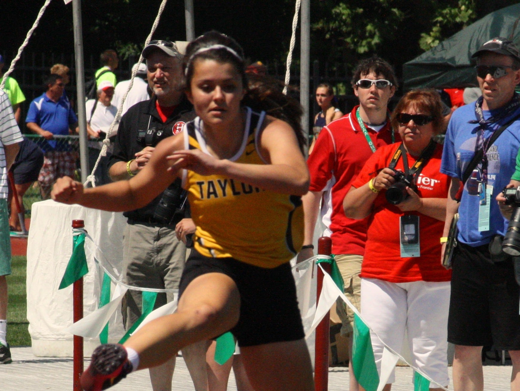 Taylor's Lizzi Lakamp competes in a 300-meter hurdles semifinal heat at the Division II state track and field championships June 6 last season at Jesse Owens Memorial Stadium at Ohio State University.