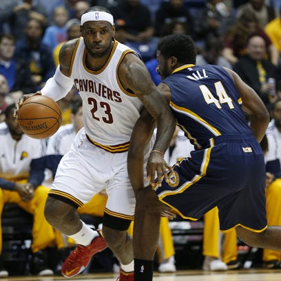 Cleveland Cavaliers forward LeBron James (23) dribbles