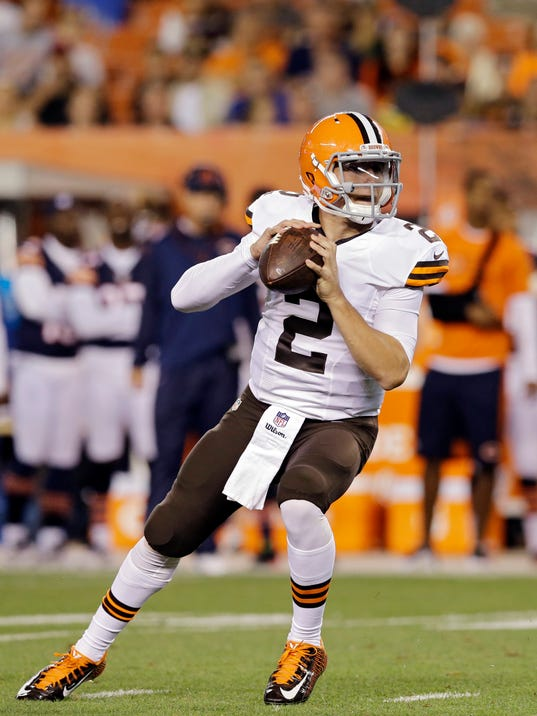 Cleveland Browns quarterback Johnny Manziel drops back to pass in the second quarter of a preseason NFL football game against the Chicago Bears, Thursday, Aug. 28, 2014, in Cleveland. (AP Photo/Tony Dejak)