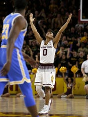 Arizona State guard Tra Holder (0) reacts after scoring