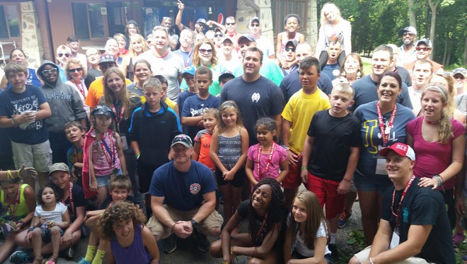 On the count of three, the 7- to 14-year-olds at the Summer Camp for Burn-Injured Youth thanked the Oshkosh Fire Department and smiled for the camera at Camp Timber-Lee in East Troy.
