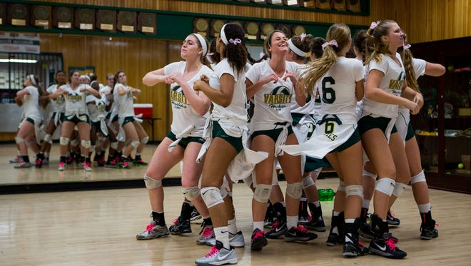 The Horizon High School varsity volleyball team dances before a celebration of head coach Valorie McKenzie's 800th career win October 10, 2014 in Scottsdale.