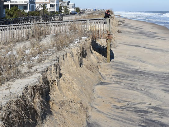 Beach erosion in downtown Bethany Beach.  Clean up