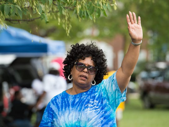 The Rev. Jean Williams of Bear waves her hand in the
