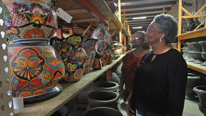 Diana Anderson and Leshay Beierly look at pottery at Corner Collection On Line.