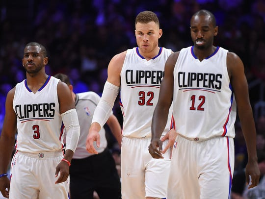 Chris Paul, Blake Griffin and Luc Mbah a Moute walk