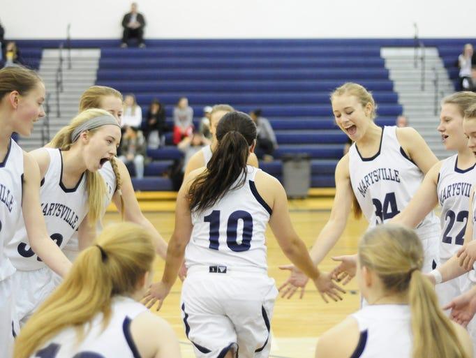 Marysville's Lydia Sawdon high-fives teammates before