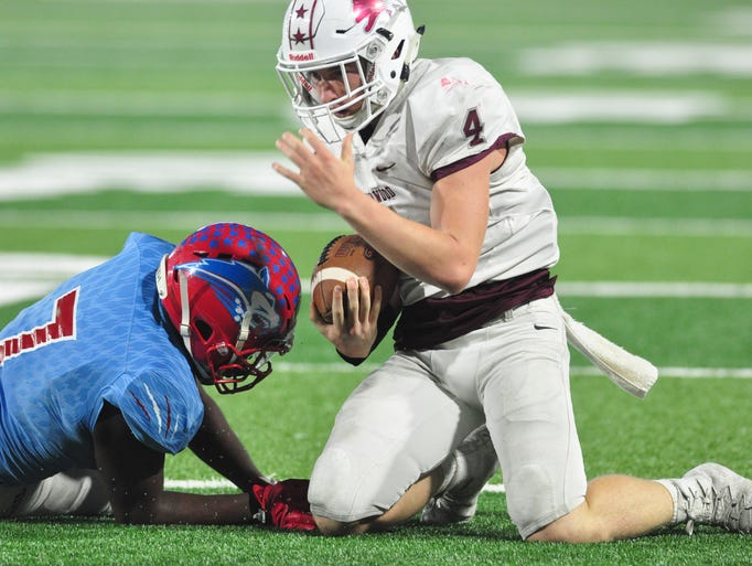 Brownwood quarterback Tommy Bowden is brought down
