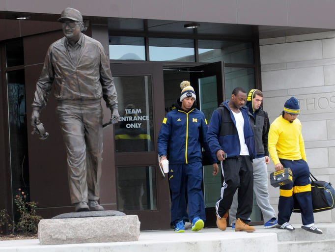 Michigan football players walk out of  Bo Schembechler