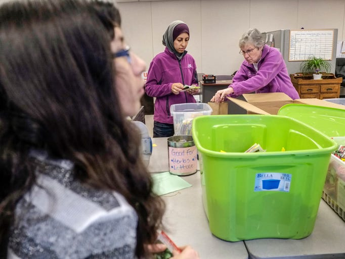 Volunteers Pack Bags Of Seeds For The Greater Lansing Food Bank Garden