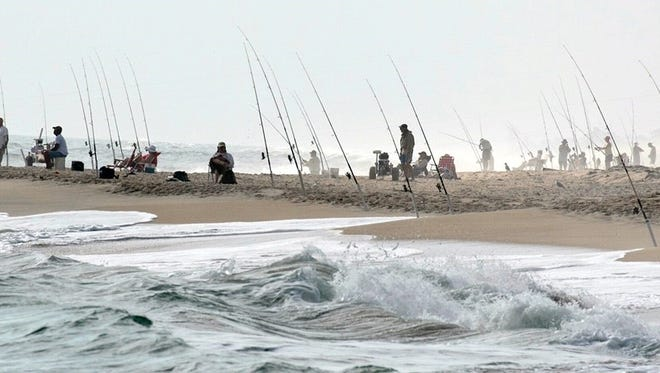 Got pompano? A typical winter season lineup of surf fishermen at Sebastian Inlet State Park.