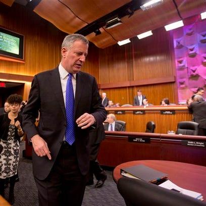 New York City Mayor Bill de Blasio arrives to testify at a joint legislative budget hearing hearing in Albany Tuesday, Jan. 26, 2016,