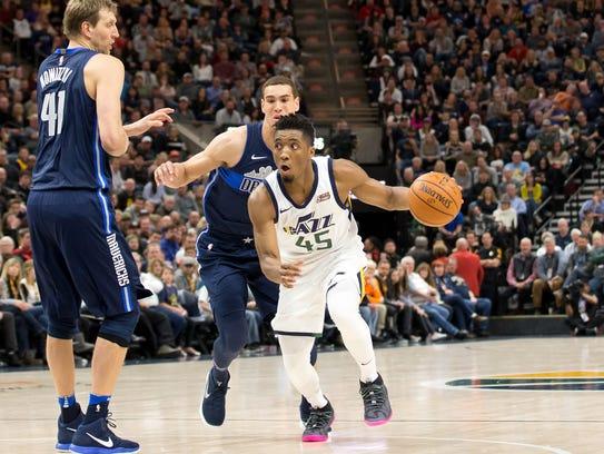 Utah Jazz guard Donovan Mitchell (45) dribbles the