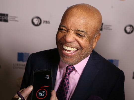 Motown co-founder Berry Gordy talks with the media
